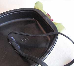 Attach elastic headband to the inside of the dinner tray