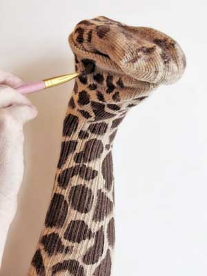 Painting the Giraffe Sock Puppet