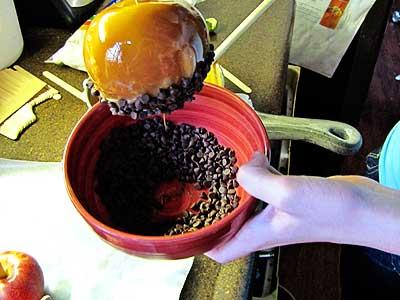 Dipping Caramel Apples in Sprinkles