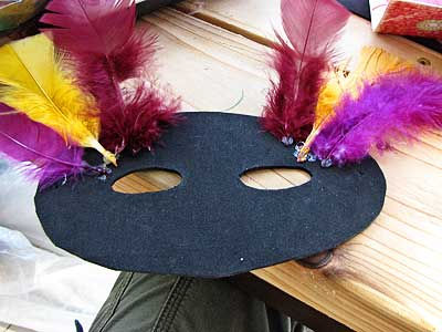 Glueing Feathers to the Masquerade Mask