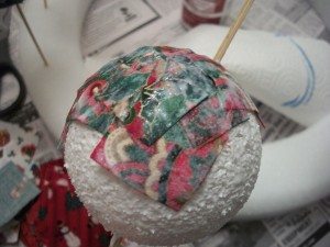Cover your ornament with decoupage and fabric scraps.