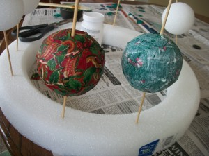 The Christmas ornament on the left is dry, and the one on the right is wet.