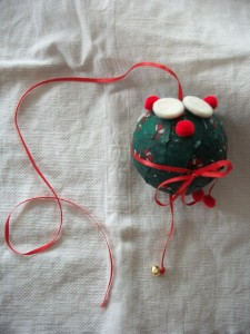 My preschooler directed me as I hot glued buttons and pom-poms all over her Christmas ornament.