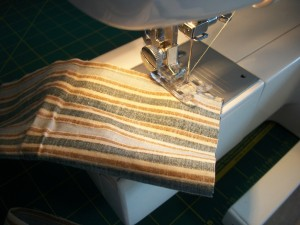 Sewing the fabric together for your snake draft blocker.
