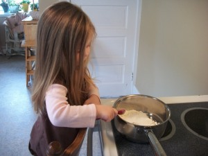 Measure dry play dough ingredients into a saucepan