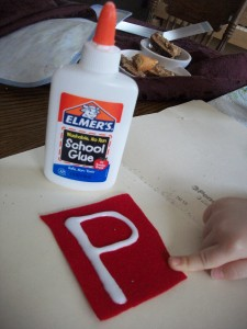 Use white glue to draw each letter onto your felt.