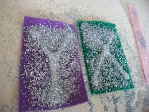Sprinkle the letters liberally with glitter.