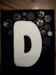 Different sized buttons give your monogram more dimension and character.