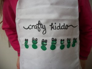 The craft apron looked a little plain, so we added some words with the fabric marker.