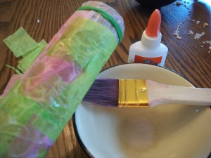 Mix white glue with a little water and use your paint brush to decoupage the tissue paper on to your rainstick.