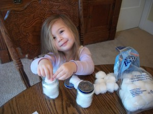 Have your kid fill the baby food (or other jar) with cotton balls.