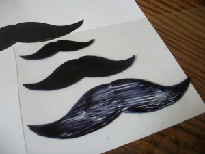 Color in the mustache with your marker.