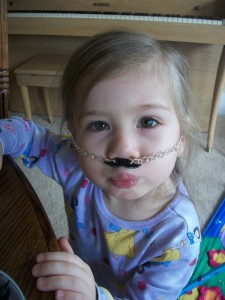 While it works as a mustache necklace, the real fun comes from sliding it up under your nose!