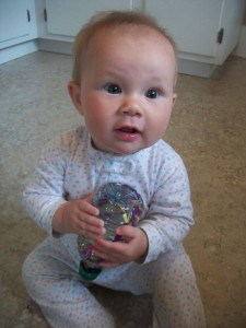 This baby toy craft was quite a hit with its intended recipient.  I love it that her big sister made it for her!
