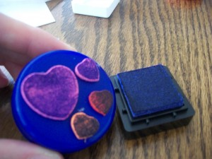 Use your ink pad to cover the craft foam shapes on your home made stamp.