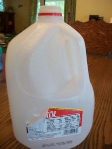 Rinse your milk jugs and peel off the labels.  It's better to do this in advance so they're dry when you work with them.