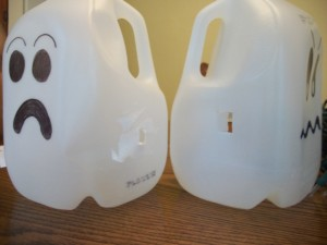 Cut holes in the sides of your milk jugs so you can string the Christmas lights through them and have them sit side-by-side.