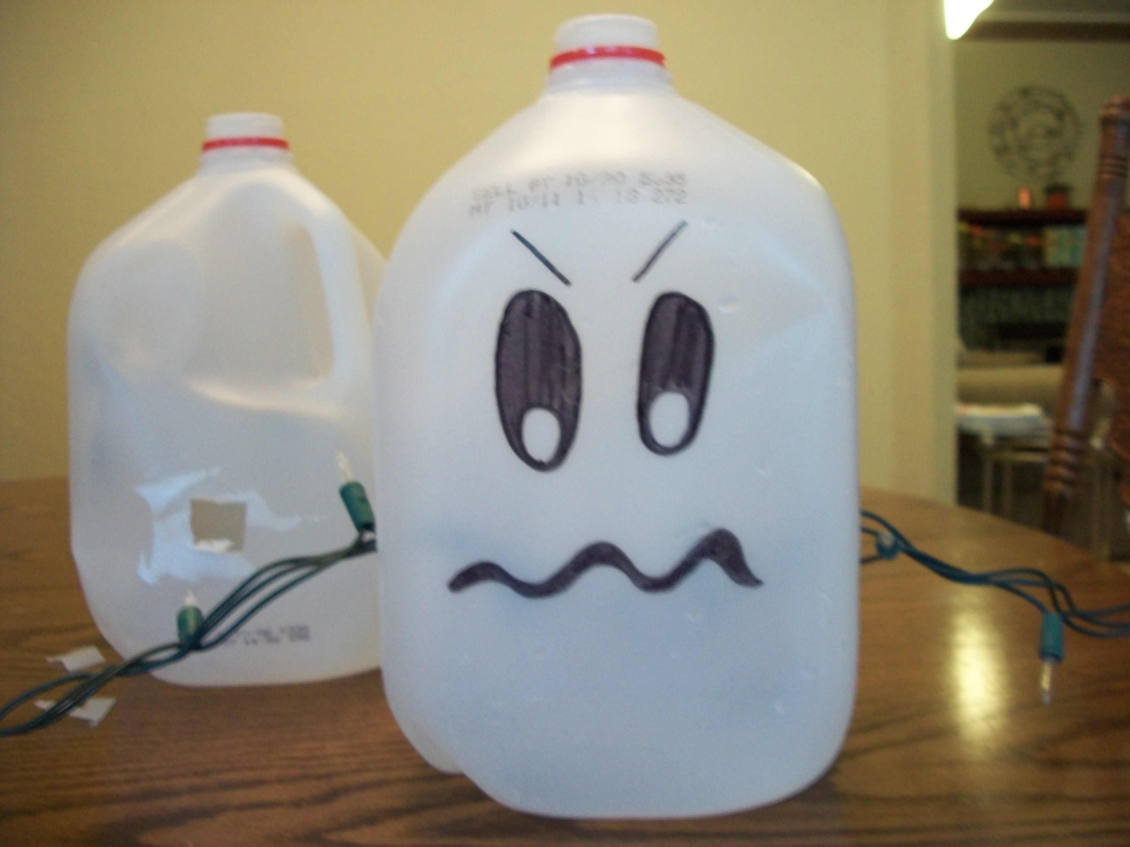 Feed the christmas lights through the holes making sure for Christmas crafts with milk jugs