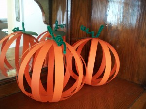 Construction paper and pipe cleaners are about all you need for this paper pumpkin craft.