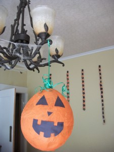 Hang the craft up using green ribbon, and curl some to fall around the top like pumpkin vines.