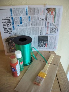 Materials for a paper bag pumpkin autumn craft.
