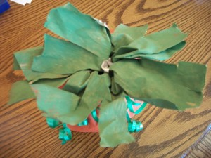 "Cut the top into approximately 1/2"" sections and bend them down to make pumpkin leaves."