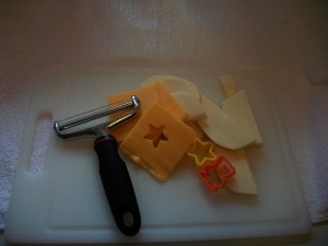 Cut fruit into bite-sized pieces.  We used small cookie cutters to make our cheese and apples into fun star shapes.