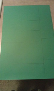 Start by tracing the sides of your tissue boxes onto your construction paper.