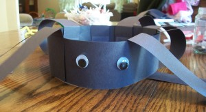 Add some googly eyes to your spider headband craft to give him some personality.