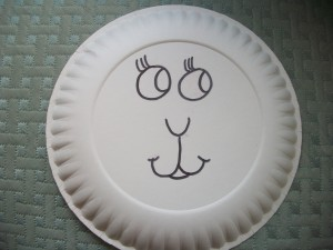 Your lamb will also need a face, so use the marker to draw it onto the other paper plate.