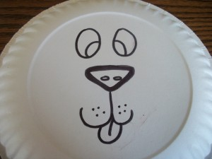 Draw a lion's face onto your paper plate.  Obviously, I'm no artist, but a 3-year-old doesn't seem to mind!