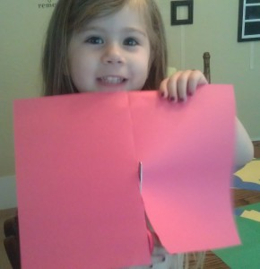 You will get two small flags from each piece of construction paper by cutting it in half the short way.