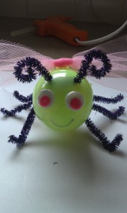 Glue or draw on eyes, and give your lightning bug a smile with your marker.