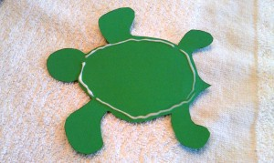 Add glue around the edges and press your shell onto the turtle.  This is the trickiest part of the turtle craft, but it ended up being easier than I feared.