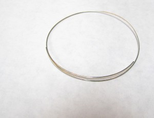 Start by taking your memory wire and cutting off one loop, leaving about a two inch overlap. This size will fit almost any wrist.