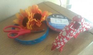Craft and dollar store supplies to create a flower headband.