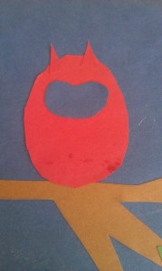 Make a sort of a bean shape to cut out and glue on for the owl's face.