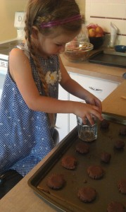 "Roll the Nutella dough into 1"" balls, place on a cookie sheet, and flatten.  Each of our batches made about 30 cookies."