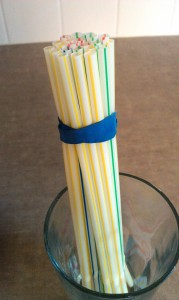 Wrap your straws with a rubber band. (A band at the top and at the bottom might work better for holding them tight.)
