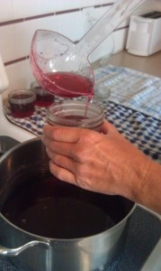 "You will feel the liquid getting a little thicker. Ladle it to within 1/8"" of the top of your jars."