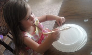 Cover the back of your paper plate with white glue. We used a paint brush to spread it around.