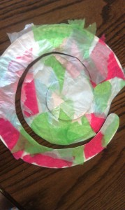 Cut the paper plate into a spiral. I rounded off the beginning point to make the snail's head.