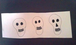 Freehand draw some skulls on your white paper, or print some off from clip art.