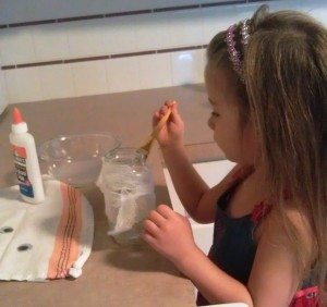 Cut your cheesecloth into strips.  We attached ours by mixing white glue and water and then brushing it on as we wrapped the jar.