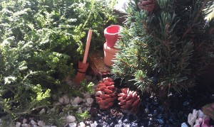 Here's a little gardening scene within our fairy garden.