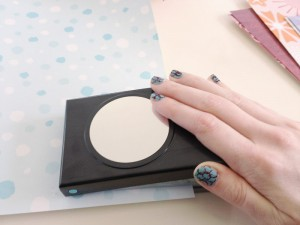 Use an inexpensive circle paper punch