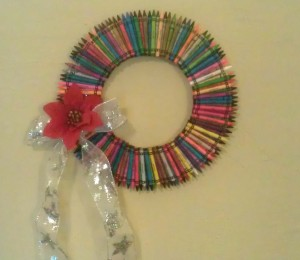 Since ours was a teacher Christmas gift, we added a bow and poinsettia to our crayon wreath.