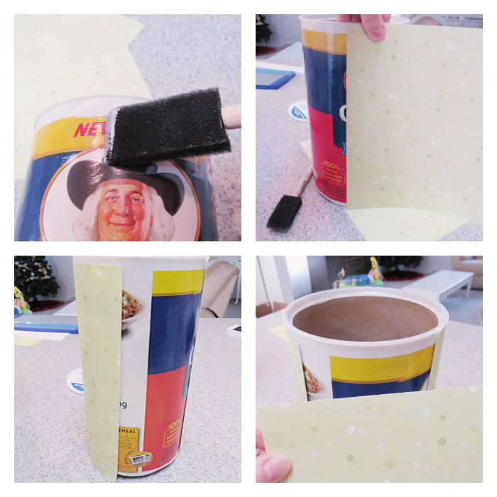 Take your scrapbook paper and cut to fit the height of the can.