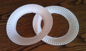 Cut the center out of your paper plate to make your wreath form.