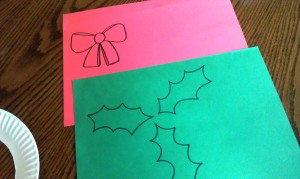 Freehand or find a template to make some embellishments for your Christmas wreath craft.  We did holly leaves and a bow for ours.